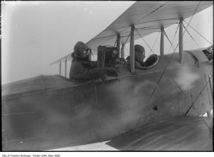 *** Local Caption *** Item consists of a photograph showing William James Sr. filming from a plane. The pilot is Bert Acosta.
